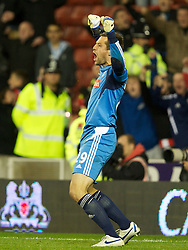 STOKE-ON-TRENT, ENGLAND - Tuesday, September 20, 2011: Stoke's goalkeeper Thomas Sorensen celebrates saving the last penalty kick against Tottenham Hotspur during the Football League Cup 3rd Round match at the Britannia Stadium. (Pic by David Rawcliffe/Propaganda)