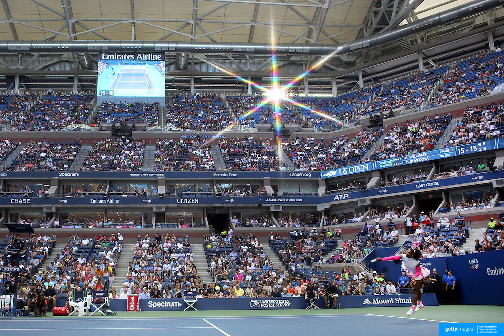 2016 U.S. Open - Day 8  Serena Williams of the United States serves against Yaroslava Shvedova of Kazakhstan in the Women's Singles round four match on Arthur Ashe Stadium on day eight of the 2016 US Open Tennis Tournament at the USTA Billie Jean King National Tennis Center on September 5, 2016 in Flushing, Queens, New York City.  (Photo by Tim Clayton/Corbis via Getty Images)<br /> <br />  (Note to editors: A special effects starburst filter was used in the creation of this image)