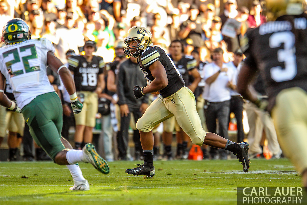October 5th, 2013:  Colorado Buffaloes freshman running back Michael Adkins II (19) rushes the ball for a gain in the second quarter of the NCAA football game between the University of Oregon Ducks and the Colorado Buffaloes at Folsom Field in Boulder, Colorado