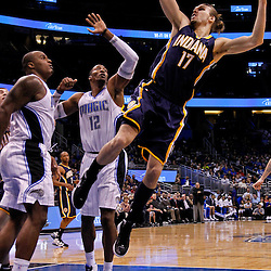 March 11, 2012; Orlando, FL, USA; Indiana Pacers center Louis Amundson (17) is fouled by Orlando Magic power forward Glen Davis (11) during the fourth quarter of a game at  Amway Center. The Magic defeated the Pacers 107-94.  Mandatory Credit: Derick E. Hingle-US PRESSWIRE
