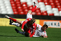 Photo: Rich Eaton. <br /> <br /> Nottingham Forest v AFC Bournemouth. Coca Cola Championship. 11/08/2007. Forest's Kris Commons (top) is tackled by Bournemouth's Warren Cummings.