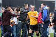 Newport county player Michael Flynn celebrates with fans after their win as they book their place in the Wembley final. Blue square bet premier div, play off semi final match, 2nd leg, Newport county v Grimsby Town at Rodney Parade in Newport, South Wales on Sunday 28th April 2013. pic by Andrew Orchard,  Andrew Orchard sports photography,