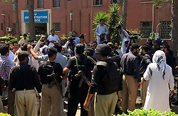June 13, 2017 - Pakistan - PESHAWAR, PAKISTAN, JUN 13: Police resorted to baton-charge and arresting to disperse the .protesters of Young Doctors Association (YDA) during demonstration for acceptance of their .demands, at Hayatabad Medical Complex in Peshawar on Tuesday, June 13, 2017. (Credit Image: © PPI via ZUMA Wire)