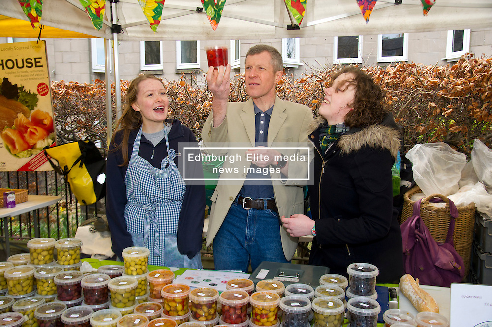 Pictured: Alice Crighton, on her first day at the market,  Willie Rennie and Hannah Bettsworth, Liberal Democrat candidate for Edinburgh Central and the Lothian regional list<br /> <br /> Liberal Democrat leader Willie Rennie and  Hannah Bettsworth, Liberal Democrat candidate for Edinburgh Central and the Lothian regional list, headed to Stockbridge today to meet Easter shoppers and stallholders at the Sunday farmers market. <br /> <br /> Ger Harley | EEm 27 March 2016