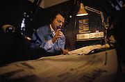 Antonio Antonacci, journalist, during the daily press review in the studio of Radio Popolare (Popular Radio) at the headquarter in Santo Stefano square, Milan, 1991. Radio Popolare is an Italian free and indipendent radio station; its programs are broadcasted on FM and streaming and by satellite. &copy; Carlo Cerchioli<br /> <br /> Antonio Antonacci, durante la quotidiana rassegna stampa nello studio di Radio Popolare nella sede in piazza Santo Stefano, Milano, 1991. Radio Popolare, &egrave; una radio di informazione libera e indipendente; i suoi programmi sono trasmessi in FM e streaming e via satellite.