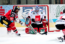 28.09.2013, Zimni Stadion, Zneim, CZE, EBEL, HC Orli Znojmo vs HC TWK Innsbruck, 12. Runde, im Bild Peter Pucher (Znojmo #33) Adam Munro (Innsbruck #51) // during the Erste Bank Icehockey League 12th round match betweeen HC Orli Znojmo and HC TWK Innsbruck  at the Zimni Stadium, Znojmo, Czech Republic on 2013/09/28. EXPA Pictures © 2013, PhotoCredit: EXPA/ Rostislav Pfeffer