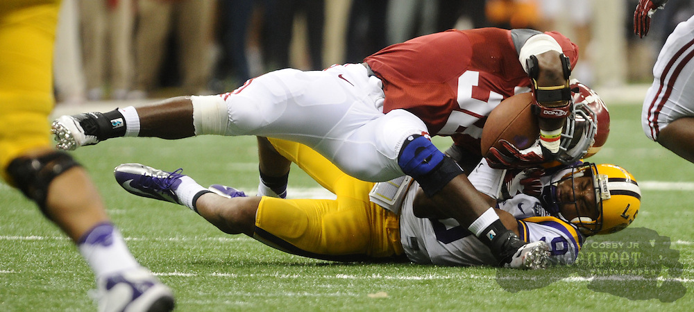 Daily Photo by Gary Cosby Jr.    ..CJ Mosley is brought down awkwardly, injuring his hip, by Jordan Jefferson after he intercepted a pass from Jefferson during the second half of the BCS National Championship Game between Alabama and LSU in the Superdome Monday night...................................