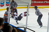 KELOWNA, CANADA - NOVEMBER 28:  Braydyn Chizen #22 of the Kelowna Rockets takes down Dawson Holt #19 of the Vancouver Giants during first period on November 28, 2018 at Prospera Place in Kelowna, British Columbia, Canada.  (Photo by Marissa Baecker/Shoot the Breeze)