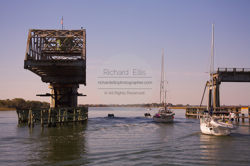Boats pass under the Sullivan's Island, South Carolina swing bridge along the Intercoastal Waterway near Charleston.