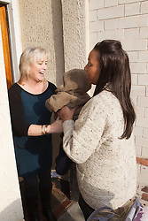 Mother handing over child at childminder's. (This photo has extra clearance covering Homelessness, Mental Health Issues, Bullying, Education and Exclusion, as well as the usual clearance for Fostering & Adoption and general Social Services contexts,)
