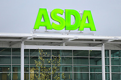 © Licensed to London News Pictures. 28/04/2018. LONDON, UK.  Signage for an ASDA superstore is seen in Watford, north west London.   ASDA and Sainsbury's are reported to be in negotiations for a GBP10m merger to create combined group of 2,800 stores representing over 30% of the UK grocery market.  Photo credit: Stephen Chung/LNP
