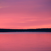 """""""Mackinac in Silhouette""""<br /> <br /> Beautiful pink and purple hues and Mackinac Island in silhouette in a lovely sunrise image over Lake Huron in Michigan's Upper Peninsula!<br /> <br /> Sunrise Images by Rachel Cohen"""