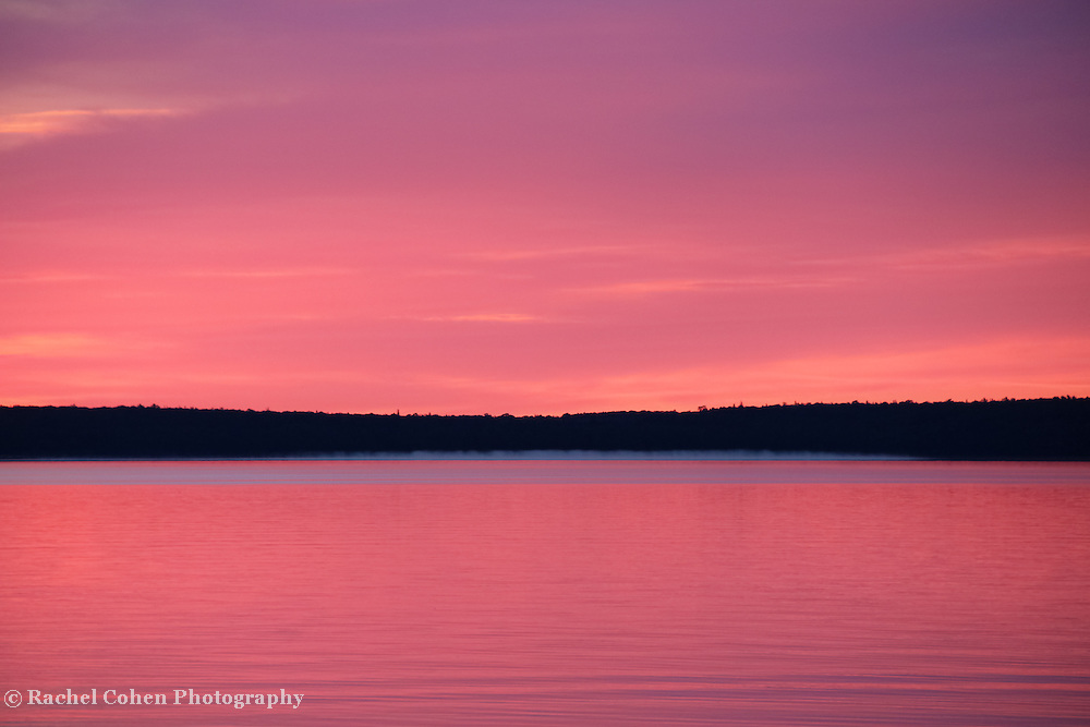&quot;Mackinac in Silhouette&quot;<br /> <br /> Beautiful pink and purple hues and Mackinac Island in silhouette in a lovely sunrise image over Lake Huron in Michigan's Upper Peninsula!<br /> <br /> Sunrise Images by Rachel Cohen