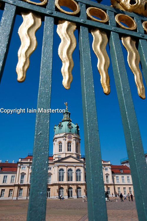 View of Schloss Charlottenburg palace through ornate gilded railings in Berlin 2009