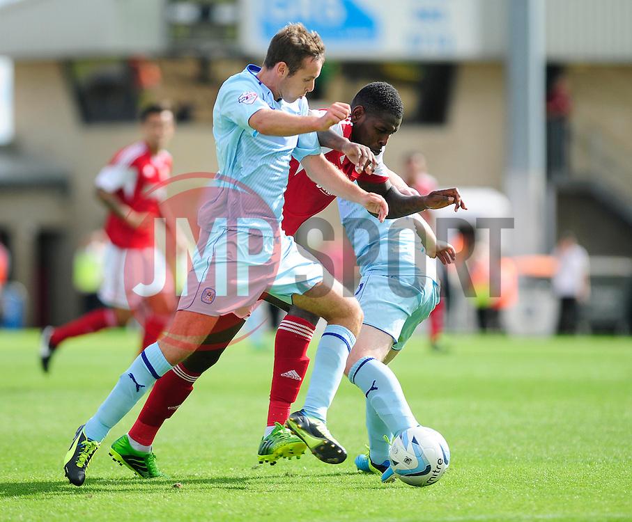 Bristol City's Jay Emmanuel-Thomas attempts to squeeze past to opposing players - Photo mandatory by-line: Dougie Allward/JMP - Tel: Mobile: 07966 386802 11/08/2013 - SPORT - FOOTBALL - Sixfields Stadium - Sixfields Stadium -  Coventry V Bristol City - Sky Bet League One