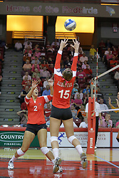 23 October 2010: Kristin Stauter sets the ball for a kill attempt by Leighann Hranka during an NCAA, Missouri Valley Conference volleyball match between the Wichita State Shockers and the Illinois State Redbirds at Redbird Arena in Normal Illinois.