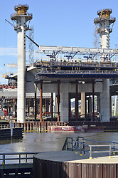 Pearl Harbor Memorial Bridge, New Haven Harbor Crossing Corridor, Interstate 95 in CT. Construction of Connecticut Department of Transportation Contract B as seen on September 9, 2011. New Northbound Span, Progress of the Replacement Bridge. When complete this will be the first Extradosed Bridge in the United States. This view includes Western Towers, Traveling Formwork. piers, river and Tomlinson Lift Bridge bumper.