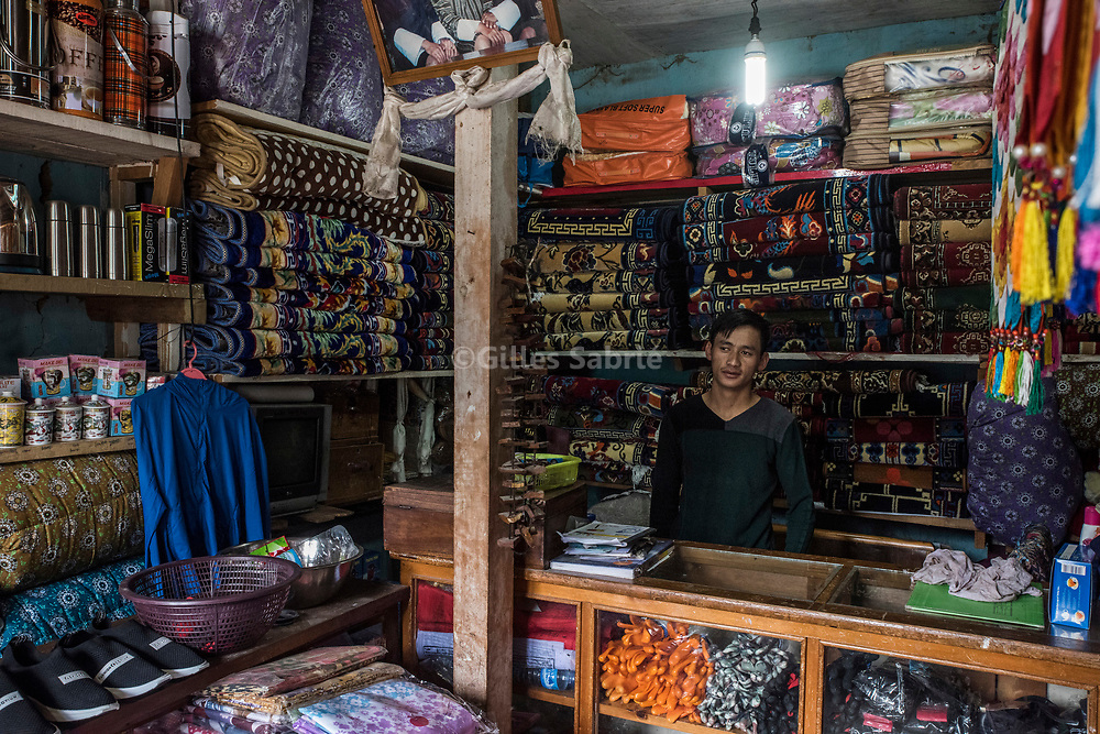 For a story by Steven Lee Myers, Bhutan<br /> Haa, Bhutan, August 3rd, 2017<br /> In Haa, a shop owner selling Chinese goods smuggled over the nearby border between Bhutan and China. The informal import of Chinese products is a source of income for locals who go on a 1 day trek to the nearest Tibetan town to buy goods and bring them back on horseback. China has shut down traffic between the two countries since the border dispute escalated last month, leading to showdown between India and China. <br /> Gilles Sabri&eacute; pour The New York Times