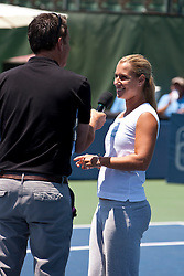 July 30, 2011; Stanford, CA, USA;  Dominka Cibulkova (SVK), right, addresses the crowd after retiring from the match against Marion Bartoli (FRA), not pictured, during the semifinals of the Bank of the West Classic women's tennis tournament at the Taube Family Tennis Stadium.