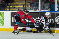 KELOWNA, CANADA - MARCH 16: Nolan Foote #29 of the Kelowna Rockets checks Evan Patrician #39 of the Vancouver Giants  on March 16, 2019 at Prospera Place in Kelowna, British Columbia, Canada.  (Photo by Marissa Baecker/Shoot the Breeze)