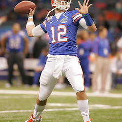 Jan 01, 2010; New Orleans, LA, USA; Florida Gators quarterback John Brantley (12) during warm ups prior to kickoff against the Cincinnati Bearcats for the 2010 Sugar Bowl at the Louisiana Superdome.  Mandatory Credit: Derick E. Hingle-US PRESSWIRE..