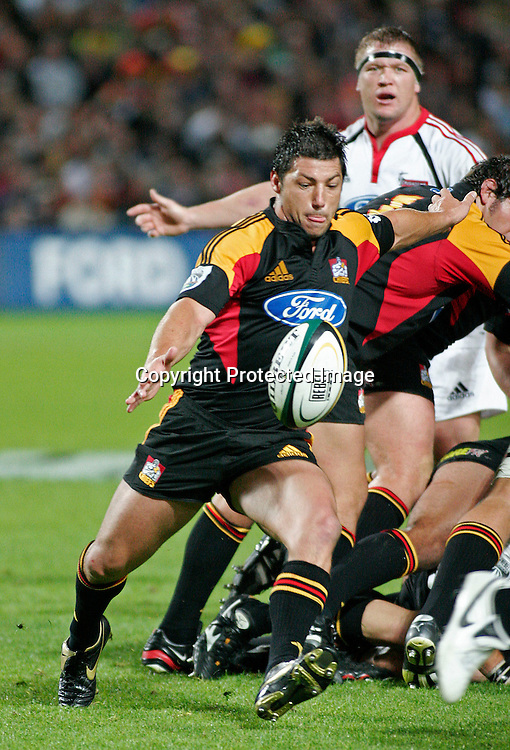 Chiefs halfback Byron Kelleher clears the ball during the Super 14 rugby union match between the Chiefs and the Crusaders at Waikato Stadium, Hamilton on Friday 10 March 2006. The Crusaders won the game 25-19. Photo: Andy Song/PHOTOSPORT