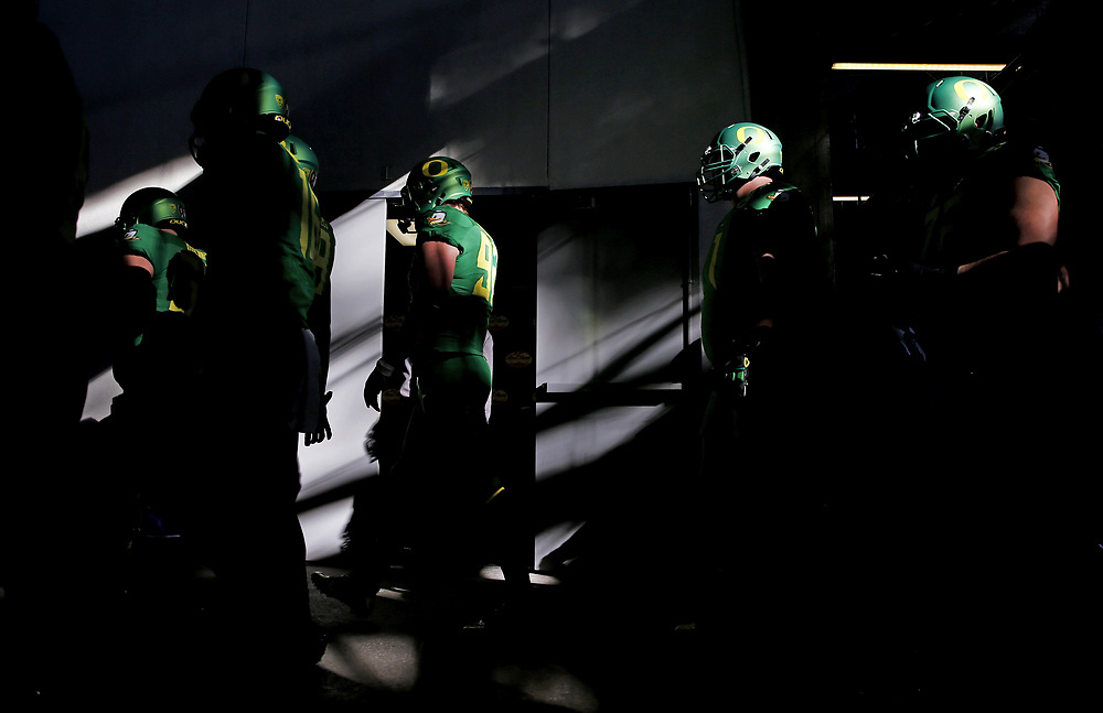 Members of the Oregon football team walk in the tunnel towards the field for player introductions prior to kickoff against Florida State on Thursday January 1, 2015 at the College Football Playoff Semifinal at 101st Rose Bowl in Pasadena, Calif.