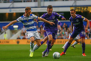 Queens Park Rangers defender Todd Kane (2) battles for possession with Portsmouth midfielder Ben Close (33) and Portsmouth defender Brandon Haunstrup (38) during the EFL Cup match between Queens Park Rangers and Portsmouth at the Kiyan Prince Foundation Stadium, London, England on 28 August 2019.