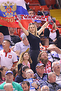 A female fan holds up a Polish scarf during the 2019 Adrian Flux British FIM Speedway Grand Prix at the Principality Stadium, Cardiff, Wales on 21 September 2019.