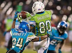 November 19, 2009; San Francisco, CA, USA;  Florida Tuskers defensive back Darius Vinnett (24) breaks up a pass intended for California Redwoods wide receiver Sonny Shackelford (80) during the fourth quarter at AT&T Park. Florida defeated California 34-27.