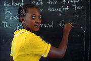KENYA, EDUCATION NAIROBI; a primary school teacher giving English language instruction at the  blackboard in her classroom in Nairobi