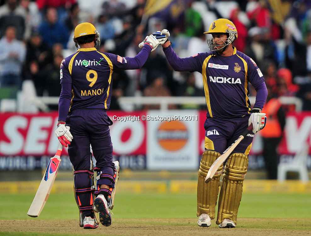 Debarata Das of the Kolkata Knight Riders and Manoj Tiwary of the Kolkata Knight Riders celebrate a 50 run partnership during the 2012 Champions League Twenty20 cricket match between the Kolkata Knight Riders and the Titans at Newlands in Cape Town on 21 October 2012 ©Ryan Wilkisky/BackpagePix