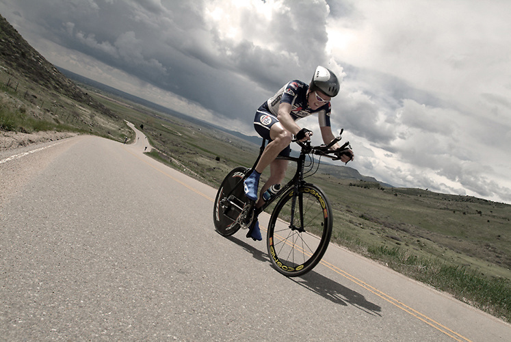 Young man on bike doing time trials