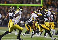 October 10, 2009: Iowa wide receiver Marvin McNutt (7) pulls in a pass for a 22 yrd gain in front of Michigan cornerback Donovan Warren (6) during the first half of the Iowa Hawkeyes' 30-28 win over the Michigan Wolverine's at Kinnick Stadium in Iowa City, Iowa on October 10, 2009.