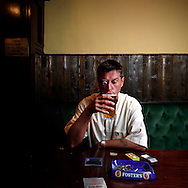 UK. Liverpool. Professional 'Streaker' Mark Roberts has a drink in a pub round the corner from Liverpool Docks..Photo©Steve Forrest/Workers' Photos..