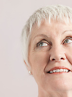 Middle-aged woman looking up and smiling close-up