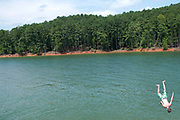 A teenager drops into Lake Allatoona on a hot summer afternoon in Ackworth, Georgia