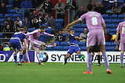 Reading midfielder Oliver Norwood strikes the ball during the Sky Bet Championship match between Cardiff City and Reading at the Cardiff City Stadium, Cardiff, Wales on 7 November 2015. Photo by Jemma Phillips.