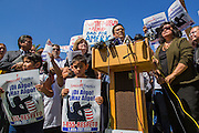 25 JUNE 2012 - PHOENIX, AZ:   Children stand in front of Arizona Democratic and civil rights leaders during a press conference in support of the Supreme Court's decision overturning most of SB1070, the state's tough anti-immigration bill, at a press conference Monday. The case, US v. Arizona, determined whether or not Arizona's tough anti-immigration law, popularly known as SB1070 was constitutional. The court struck down most of the law but left one section standing, the section authorizing local police agencies to check the immigration status of people they come into contact with.      PHOTO BY JACK KURTZ