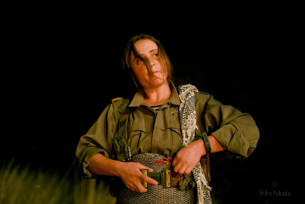 PKK member Muxayla Nergiz, 27, from Urfa in Turkey, puts on her gear before shooting a film about their struggle in Qandil Mountains, Iraqi Kurdistan. She joined PKK in 1999. Photo by
