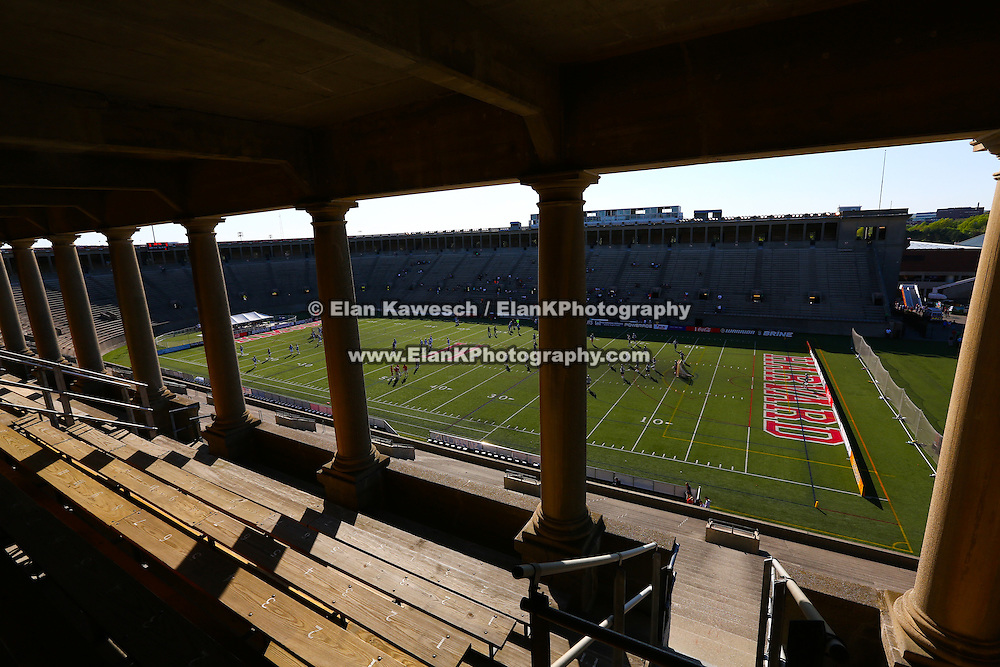 A general view of the field with players warming up prior to the game at Harvard Stadium on May 17, 2014 in Boston, Massachuttes. (Photo by Elan Kawesch)