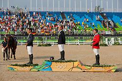Nicolas Astier (FRA), Jung Michael (GER), Dutton Phillip (USA)<br /> Jung, Michael (GER);<br /> Dutton, Phillip (USA)<br /> , <br /> Rio de Janeiro - Olympische Spiele 2016<br /> Siegerehrung Vielseitigkeit Einzelentscheidung<br /> © www.sportfotos-lafrentz.de/Stefan Lafrentz