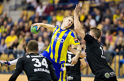 Tilen Kodrin of RK Celje PL vs Michal Szyba  of RK Gorenje during handball match between RK Celje Pivovarna Lasko and RK Gorenje Velenje in Eighth Final Round of Slovenian Cup 2015/16, on December 10, 2015 in Arena Zlatorog, Celje, Slovenia. Photo by Vid Ponikvar / Sportida