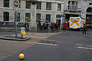 A runaway yellow balloon floats along King William Street opposite Bank Underground station in the City of London, the capital's financial district, 7th March 2018, in London England.