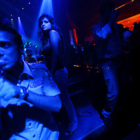 Young Arabs enjoyed a night out at Elegante, a popular Dubai disco. August 2008.
