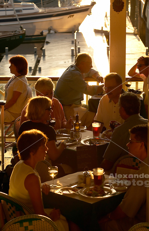 USA, Newport, RI - Sunset illuminates dining at the Clarke Cooke house