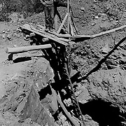 Jun 1, 1999 - La Serena, Chile - A Chilean gold miner standing at the top of shaft after working underground near La Serena in Andacollo, Chile.<br /> (Credit Image: &copy; Louie Palu/ZUMA Press)