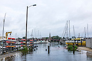 "Annapolis, Maryland - June 05, 2016: An early morning perigean spring tide brought the water from the Annapolis City Marina loading dock dozens of feet on to Fifth Street Sunday June 5th, 2016.<br /> <br /> A perigean spring tide brings nuisance flooding to Annapolis, Md. These phenomena -- colloquially know as a ""King Tides"" -- happen three to four times a year and create the highest tides for coastal areas, except when storms aren't a factor. Annapolis is extremely susceptible to nuisance flooding anyway, but the amount of nuisance flooding has skyrocketed in the last ten years. Scientists point to climate change for this uptick. <br /> <br /> <br /> CREDIT: Matt Roth for The New York Times<br /> Assignment ID: 30191272A"