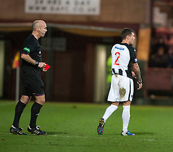 Referee Stephen Finnie red cards Dunfermline's Jordan McMillan..half time : Dunfermline v Falkirk, 26/12/2012..©Michael Schofield.