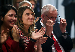 © Licensed to London News Pictures. 09/04/2018. London, UK. Labour Party leader JEREMY CORBYN (right) puts on his glasses during the launch event for the Labour Party local election campaign launch in central London.  Labour are expected to make gains in the capital, potentially taking traditionally Conservative strongholds. Photo credit: Ben Cawthra/LNP